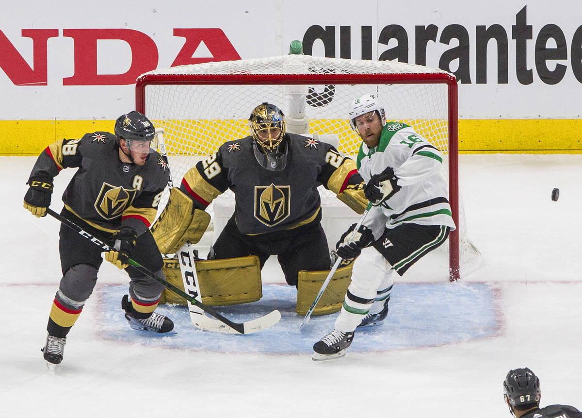 Vegas Golden Knights goalie Marc-Andre Fleury (29) makes the save on Dallas Stars' Joe Pavelski ...