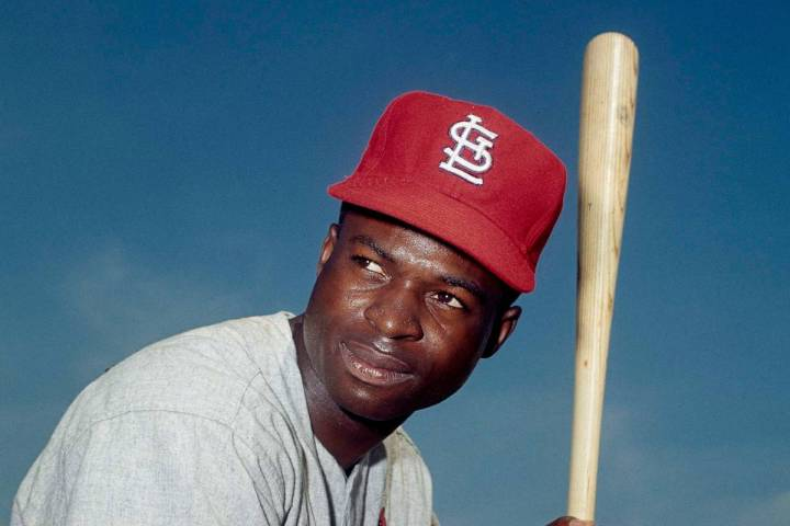 FILE - In this April 9, 1965, file photo, Lou Brock, of the St. Louis Cardinals, poses in Misso ...