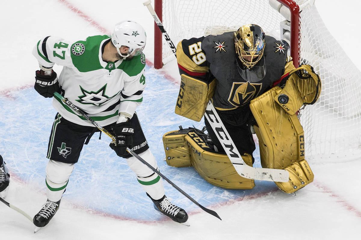 Vegas Golden Knights goalie Marc-Andre Fleury (29) makes a save on Dallas Stars' Alexander Radu ...