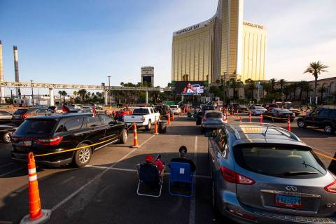 Las Vegas Aces fans watch the action during a drive-in showing of the Las Vegas Aces WNBA game ...