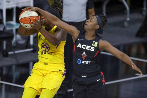 Las Vegas Aces' Sugar Rodgers, right, blocks a shot attempt by Los Angeles Sparks' Chelsea Gray ...