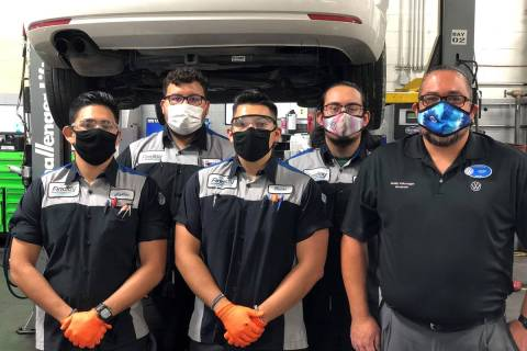Findlay Volkswagen service director John Gonzalez poses with a few of his current technicians. ...