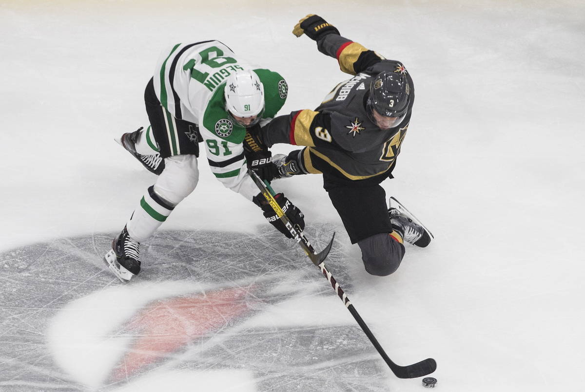 Dallas Stars' Tyler Seguin (91) and Vegas Golden Knights' Brayden McNabb (3) compete for the pu ...
