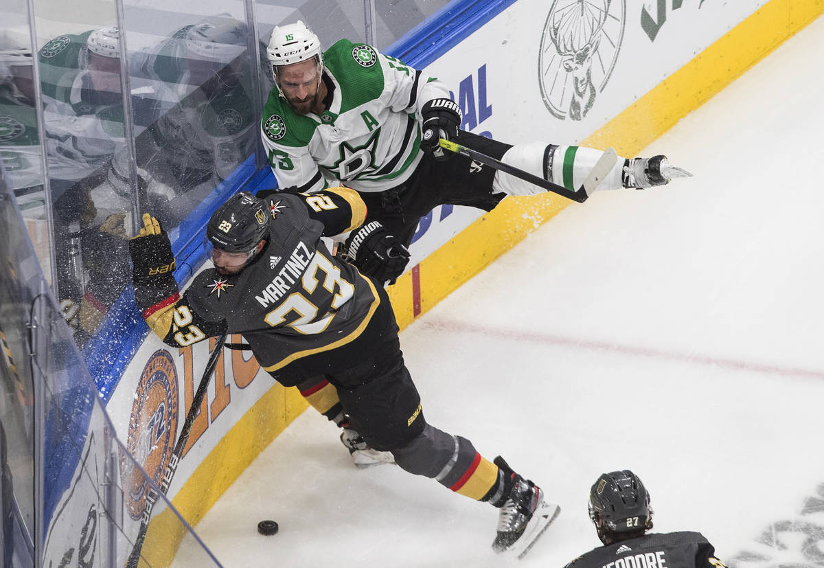 Dallas Stars' Blake Comeau (15) is checked by Vegas Golden Knights' Alec Martinez (23) during t ...