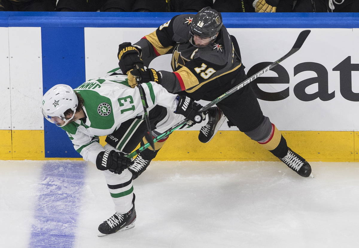 Dallas Stars' Mattias Janmark (13) is checked by Vegas Golden Knights' Reilly Smith (19) during ...