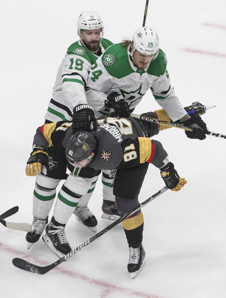 Dallas Stars' Blame Comeau (15) and Roope Hintz (24) rough up Vegas Golden Knights' Jonathan Ma ...