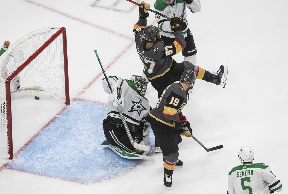 Dallas Stars goalie Anton Khudobin (35) gives up an apparent goal as Vegas Golden Knights' Max ...