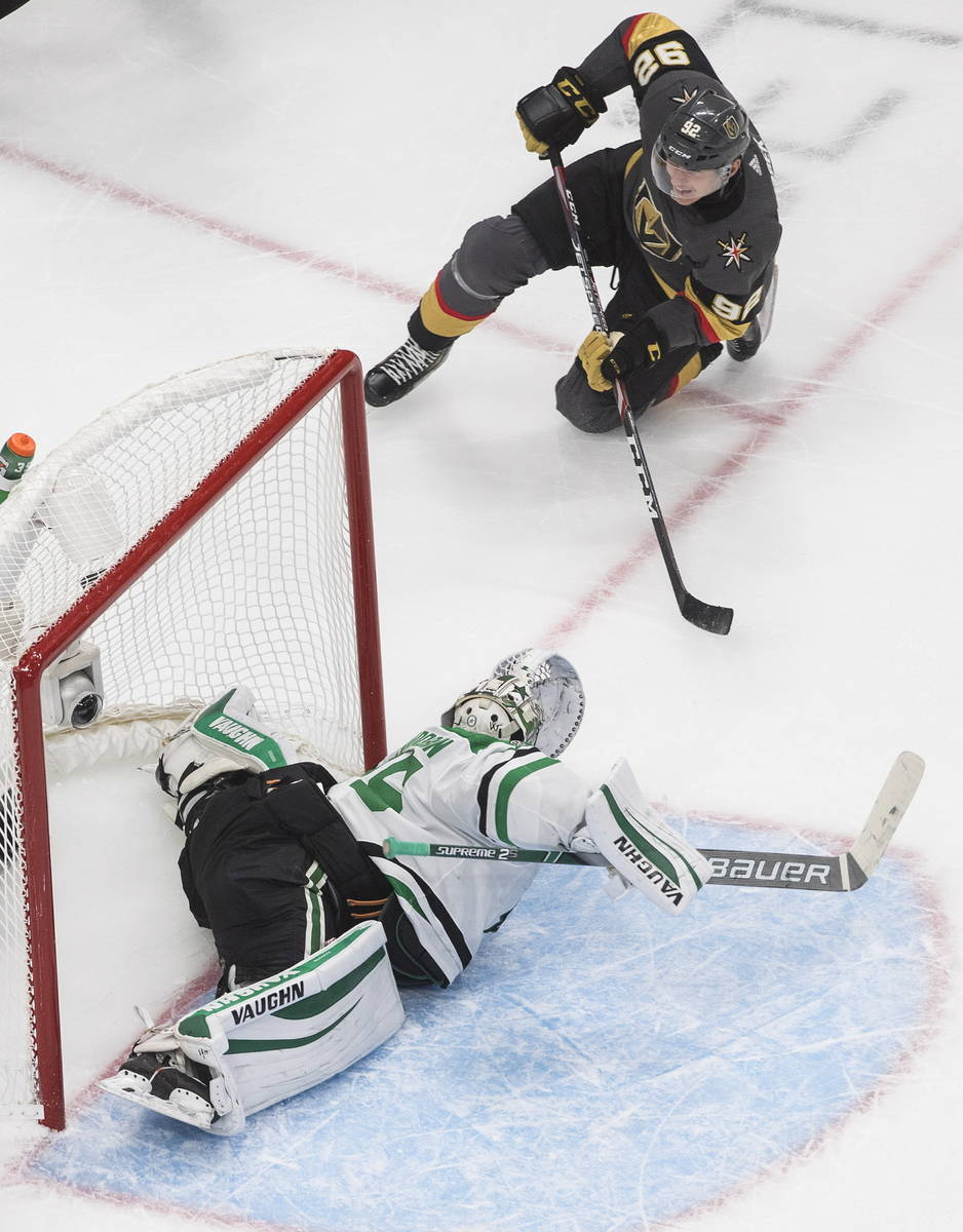 Dallas Stars goalie Anton Khudobin (35) gives up a goal as Vegas Golden Knights' Tomas Nosek wa ...