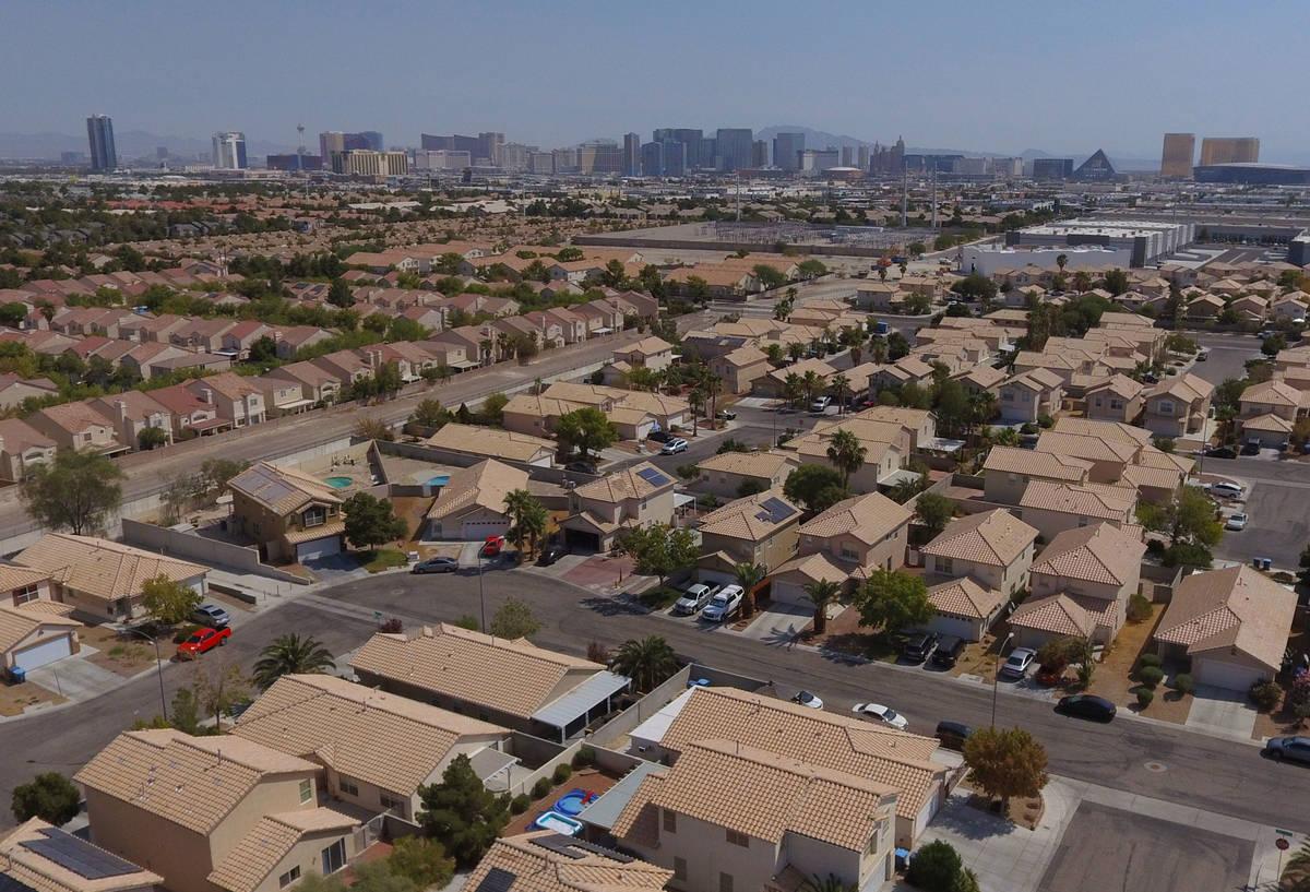 An aerial photo shows home on Dewey Drive and Autumn Cliff Way near Jones Boulevard on Tuesday, ...