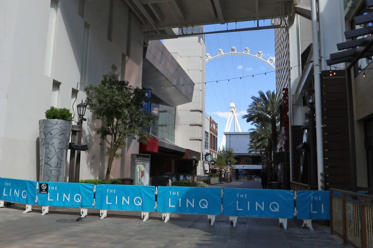 Barricades prevent people from entering the Linq Promenade remain on the Strip during the casin ...