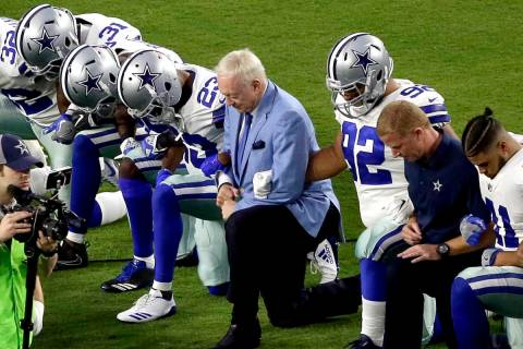 In this Monday, Sept. 25, 2017, file photo, the Dallas Cowboys, led by owner Jerry Jones, cente ...