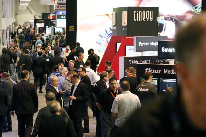 Showgoers arrive at the National Association of Broadcasters (NAB) show at the Las Vegas Conven ...