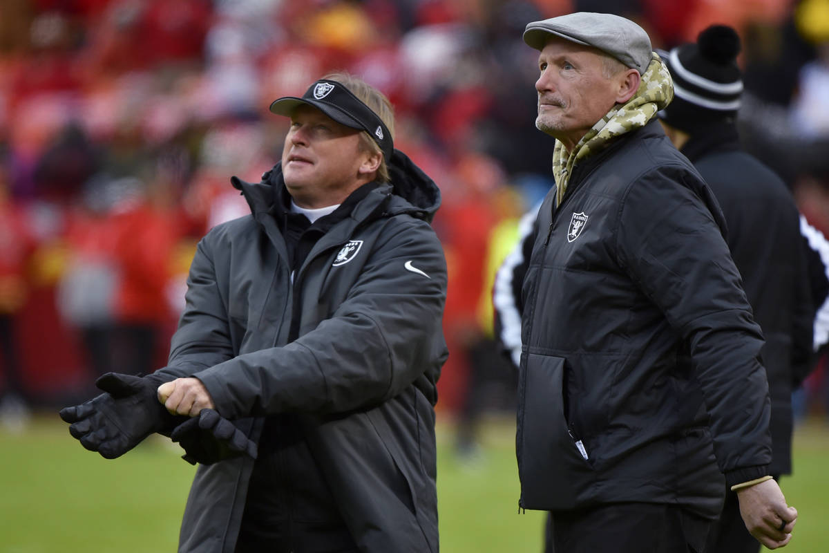 n this Dec. 1, 2019, file photo, Oakland Raiders general manager Mike Mayock stands with coach ...