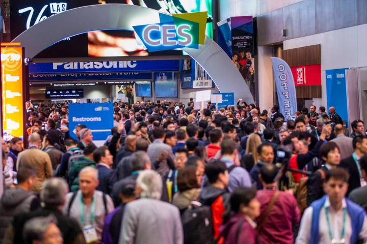 Attendees gather outside of the main entrance for Central Hall as CES Day 1 is about to open at ...