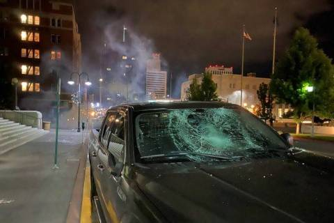 A damaged car is seen during a violent Black Lives Matter protest in downtown Reno on Saturday, ...