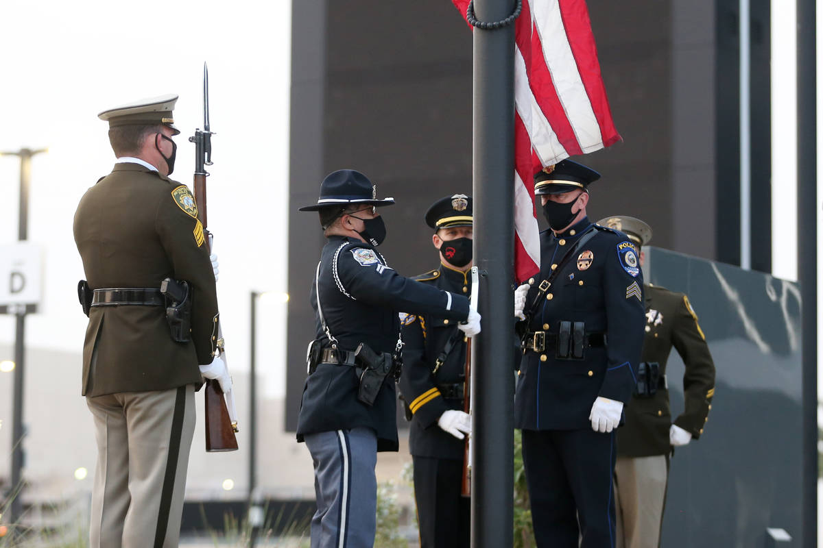 A multi-agency honor guard present the colors during a 9/11 ceremony at Allegiant Stadium in La ...