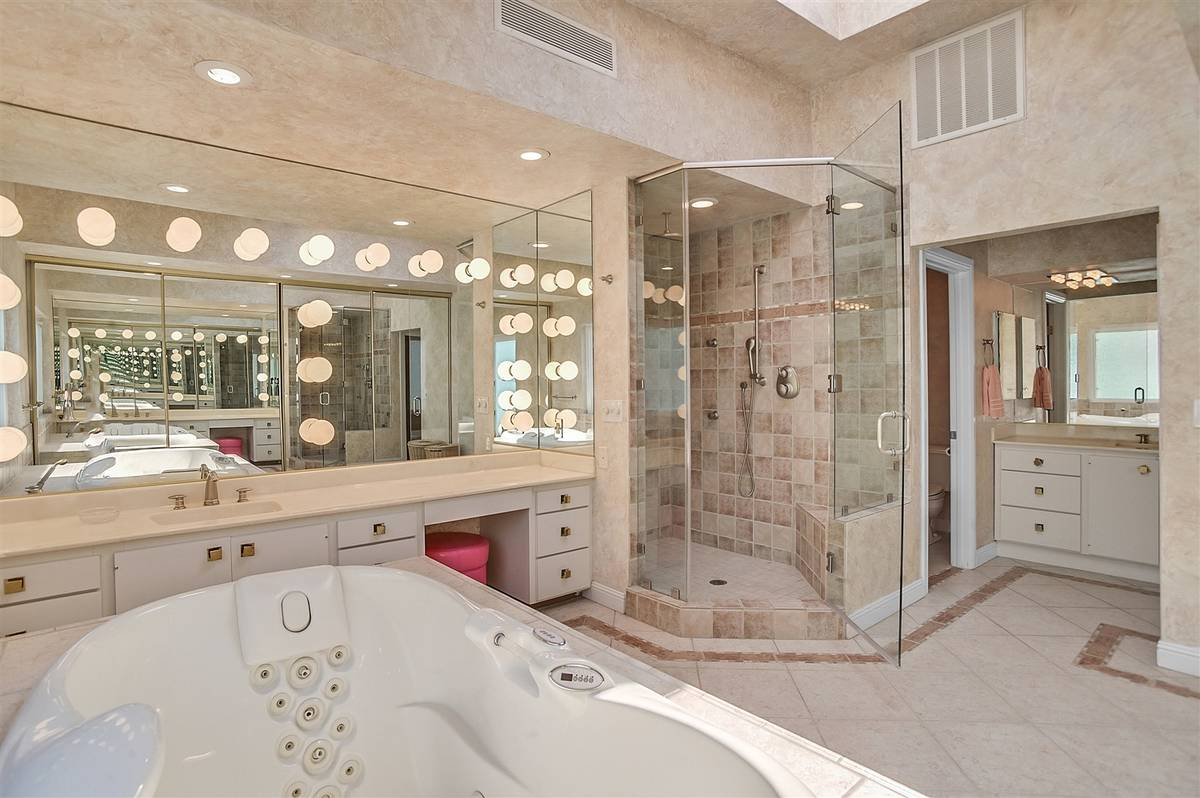 The master bath features a large shower and Jacuzzi tub that lights up and turns colors. (Narte ...