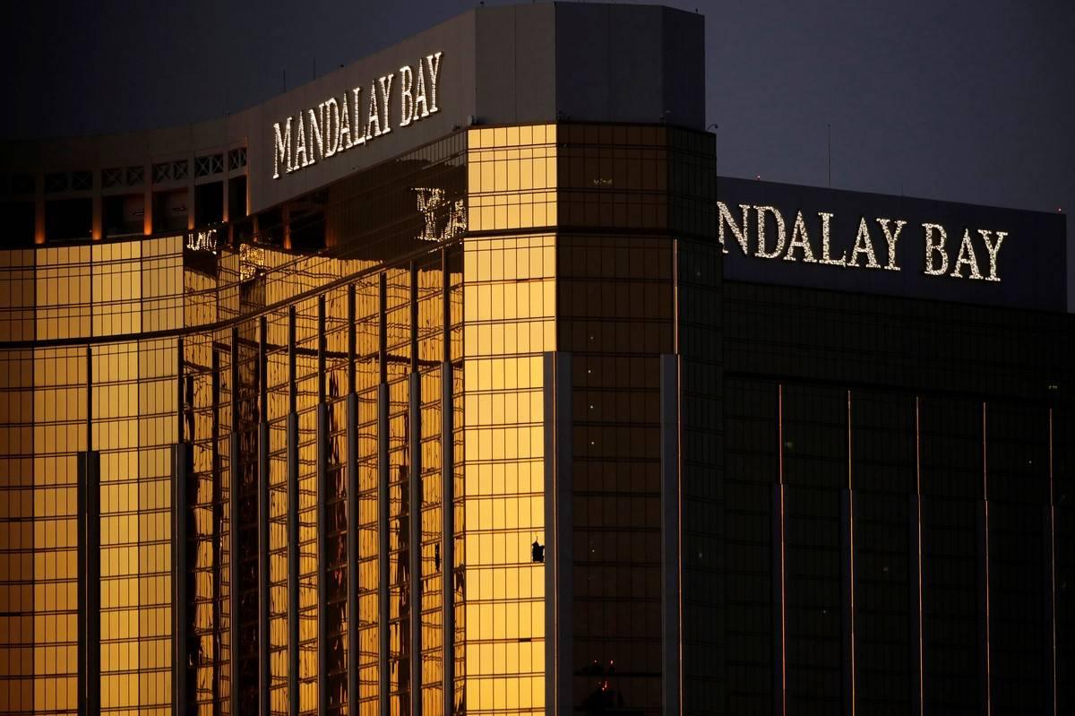 Broken windows are seen at Mandalay Bay on the Las Vegas Strip following a mass shooting at a m ...