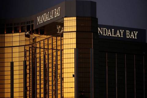 Broken windows are seen at Mandalay Bay on the Las Vegas Strip following a mass shooting at a m ...