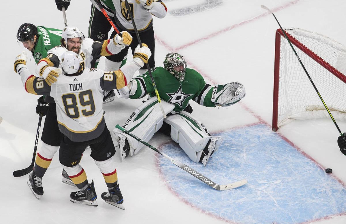 Dallas Stars goalie Anton Khudobin (35) gives up a goal as Vegas Golden Knights' Mark Stone (61 ...