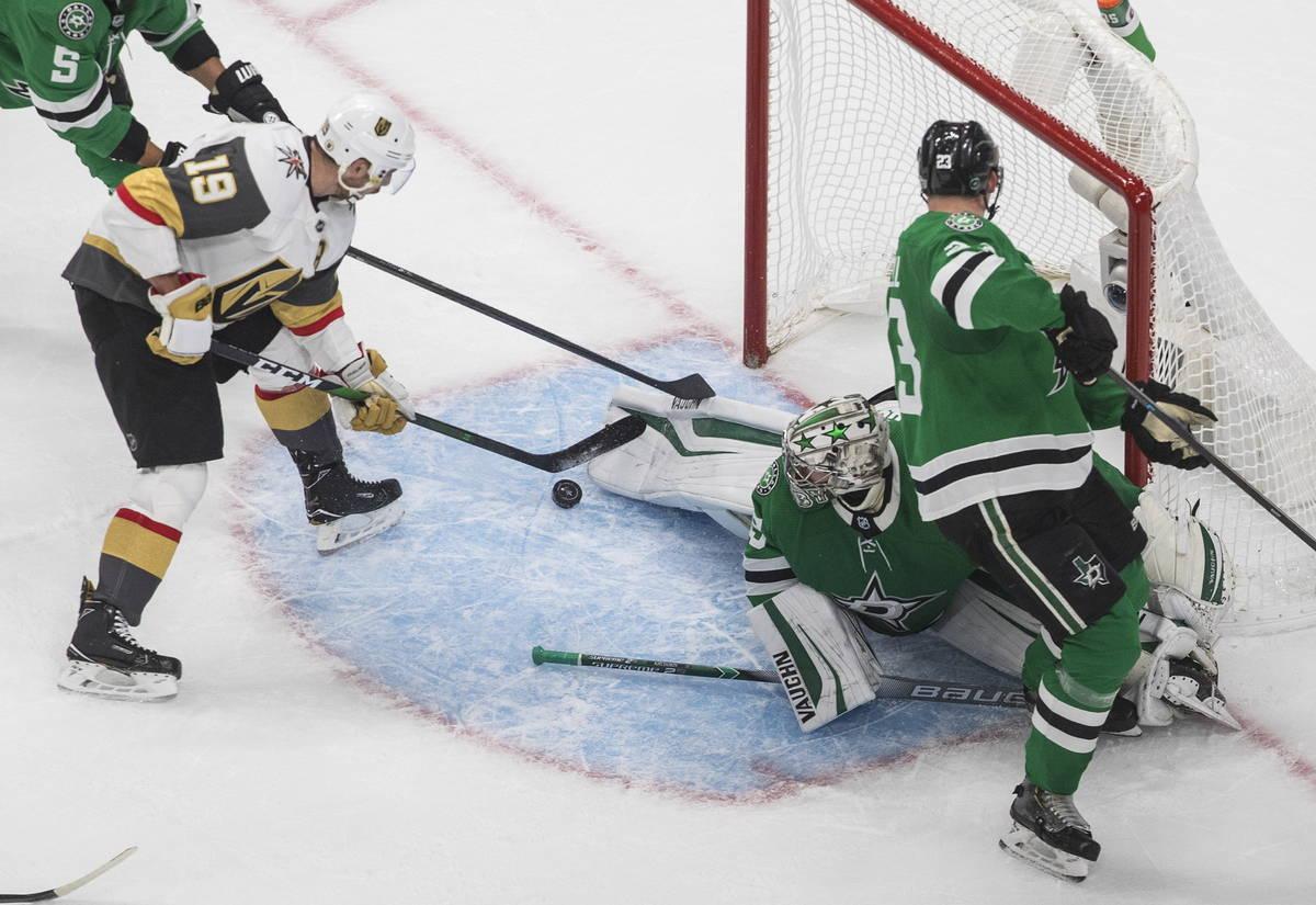 Dallas Stars goalie Anton Khudobin (35) makes a save on Vegas Golden Knights' Reilly Smith (19) ...