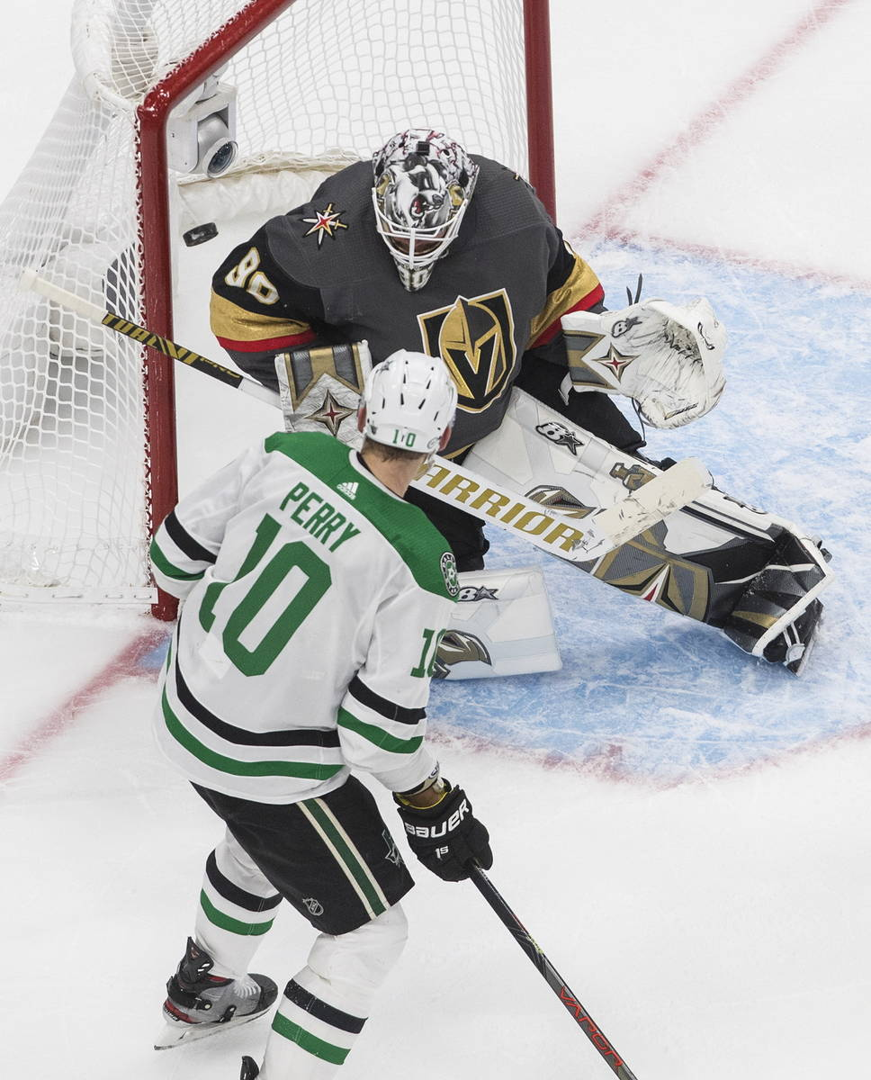 Dallas Stars' Corey Perry (10) is stopped by Vegas Golden Knights' goalie Robin Lehner (90) dur ...