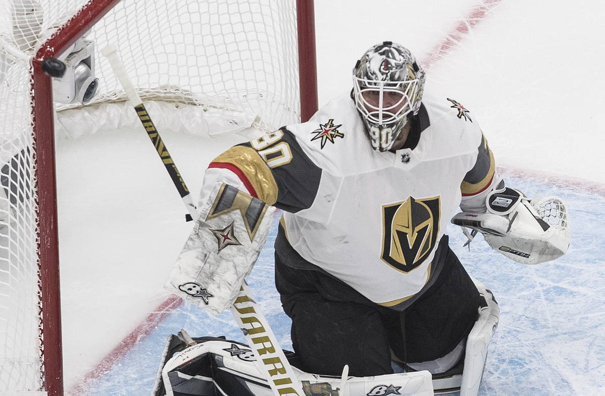 The puck hits the post as Vegas Golden Knights goaltender Robin Lehner watches during the first ...