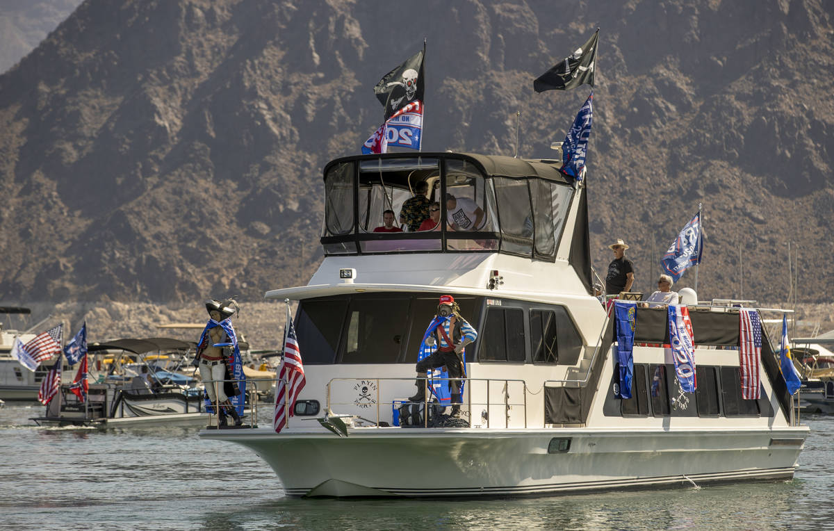 A decked out boat leaves the harbor for the President Donald Trump boat parade at the Lake Mead ...