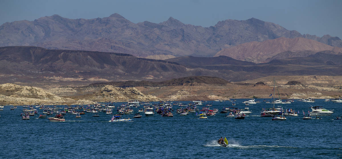 A mass of boats move along the lake during the President Donald Trump boat parade on Lake Mead ...
