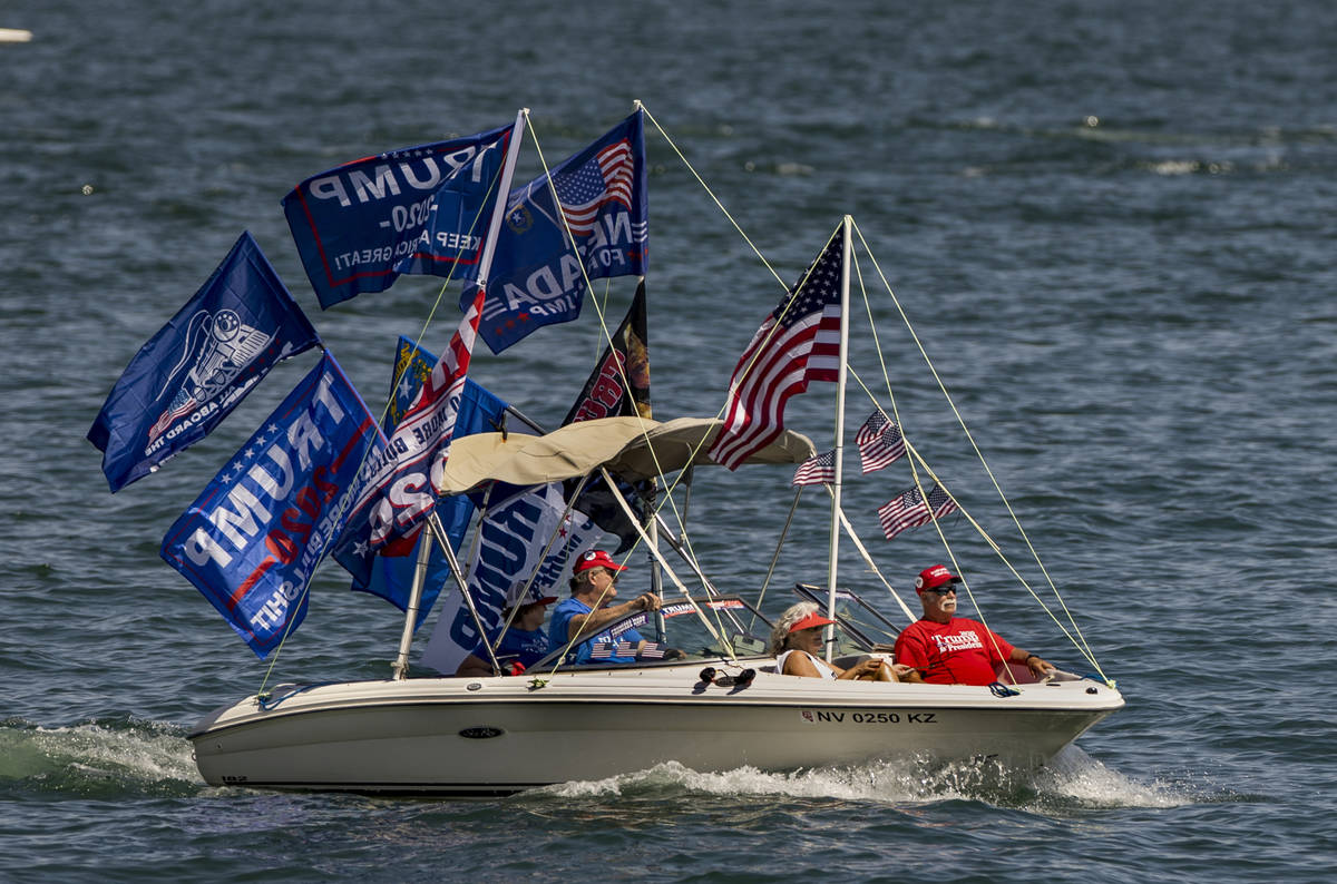 A boat is decked out with numerous flags as participants ride during the President Donald Trump ...