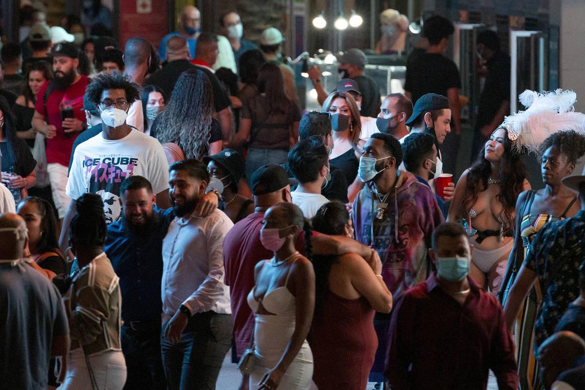 In this Sept. 5, 2020, file photos, visitors walk around the Las Vegas Strip. (Ellen Schmidt/La ...
