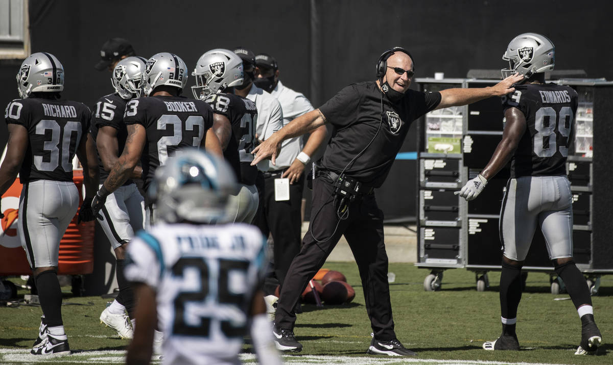 Raiders offensive coordinator Tom Cable pumps up Las Vegas Raiders wide receiver Bryan Edwards ...