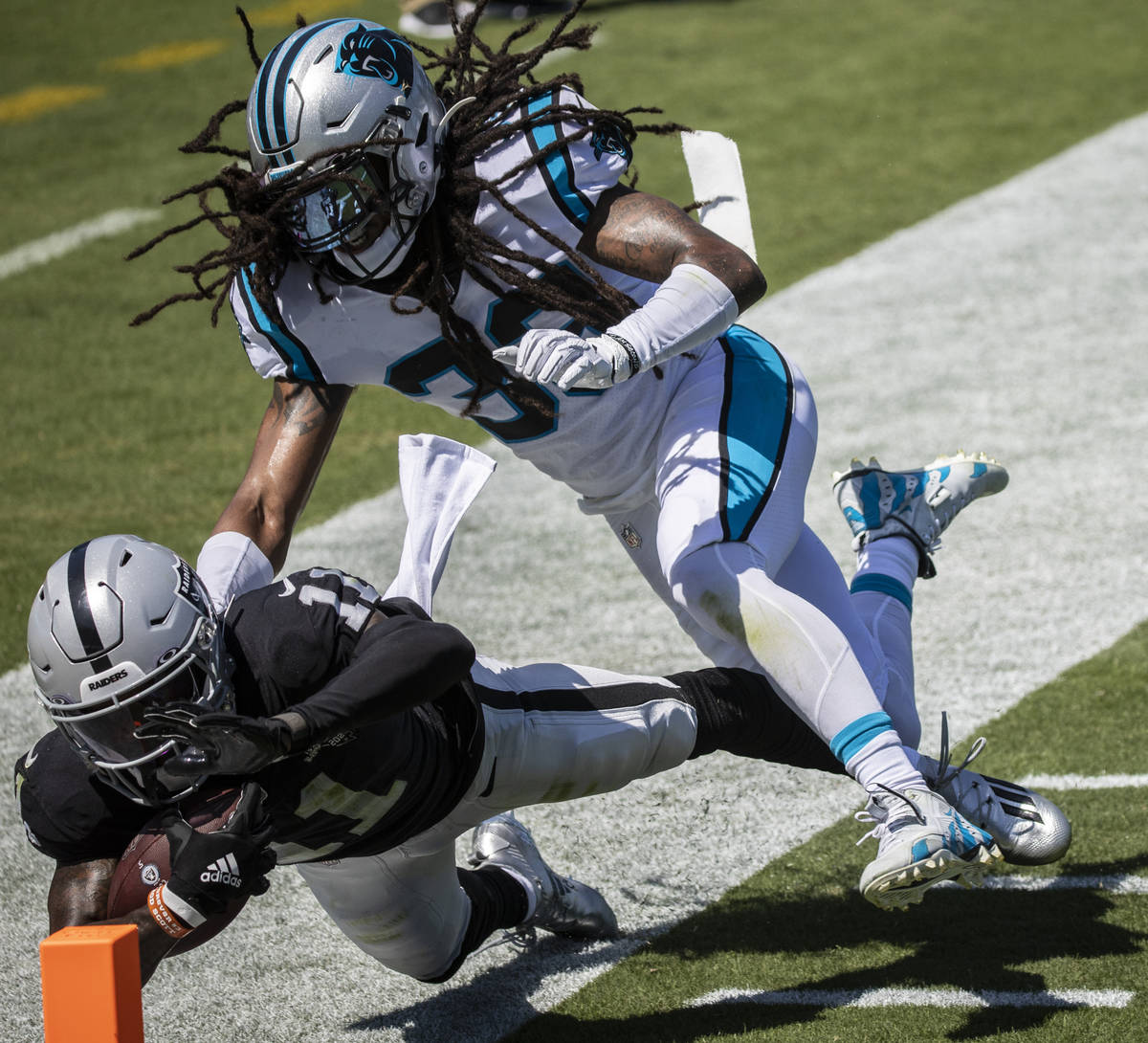 Las Vegas Raiders wide receiver Henry Ruggs III (11) collides with Carolina Panthers safety Tre ...