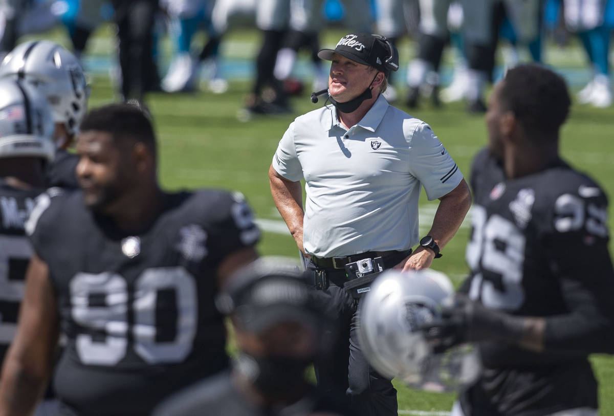 Las Vegas Raiders head coach Jon Gruden looks at the scoreboard in the 2nd quarter of an NFL fo ...