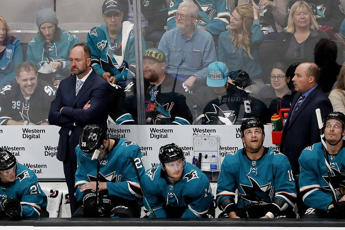 San Jose Sharks coach Peter DeBoer, left rear, stands in the bench area during the second perio ...