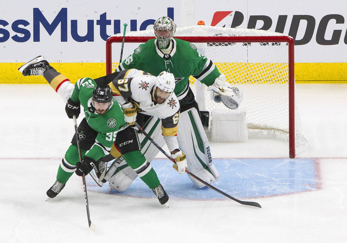 Dallas Stars' Joel Hanley (39) and Vegas Golden Knights' Max Pacioretty (67) battle in front of ...