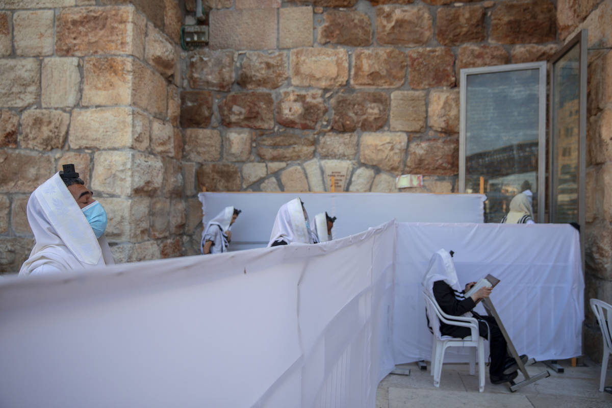 FILE - In this July 16, 2020 file photo, ultra-Orthodox Jewish men pray in divided sections whi ...