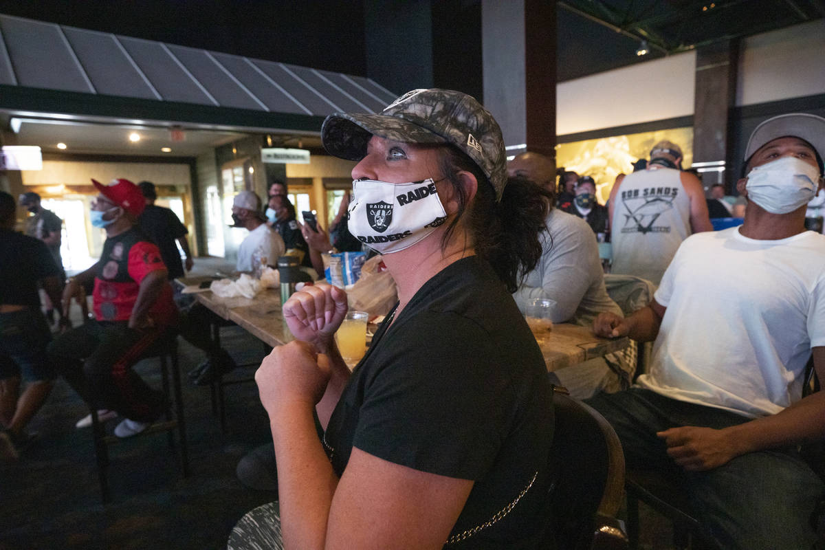 Raiders fan Kim Brooks, of Henderson, watches as the Raiders make a touchdown, viewed at the We ...