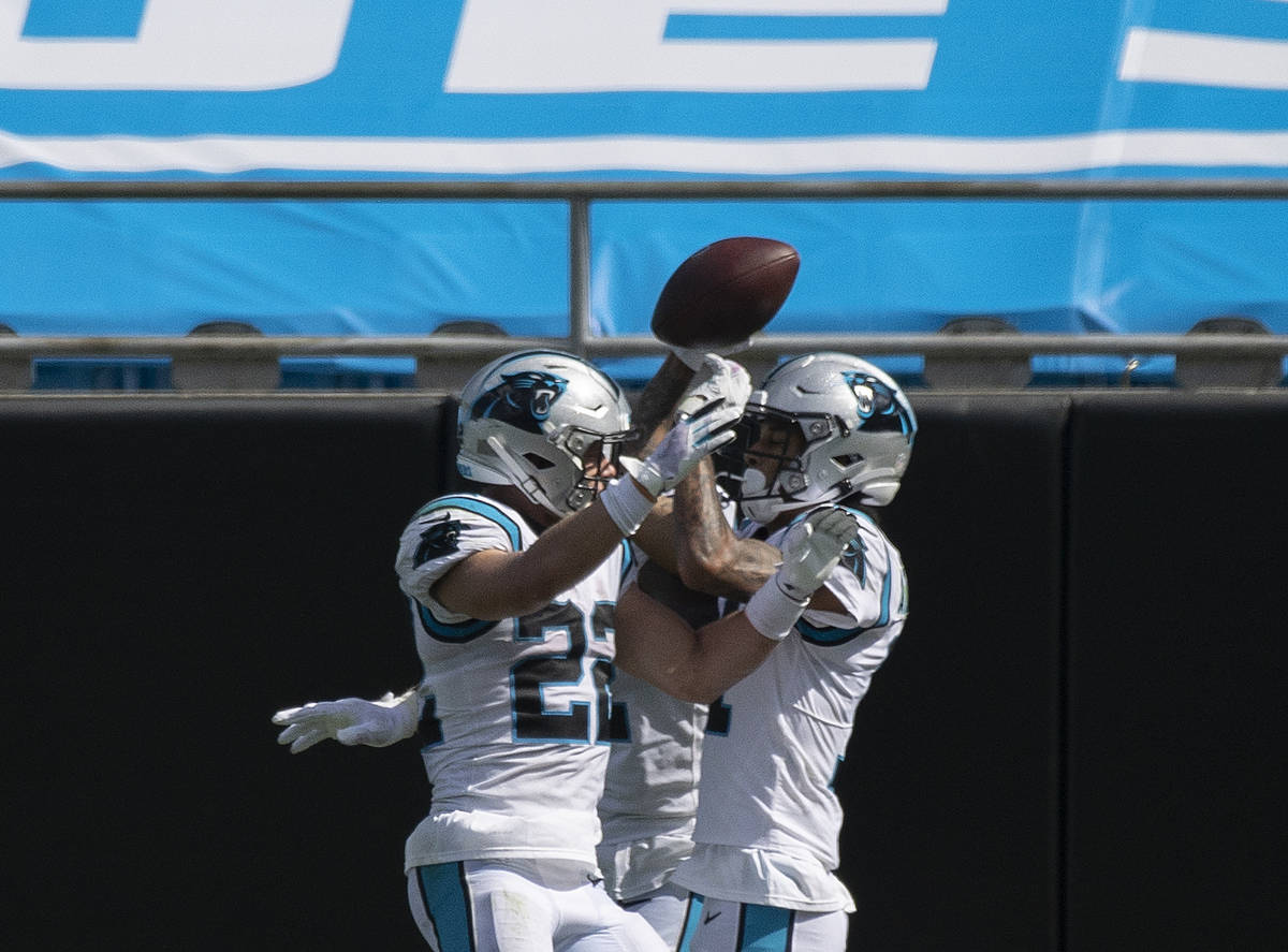 Carolina Panthers running back Christian McCaffrey (22) celebrates a Panthers touchdown with te ...