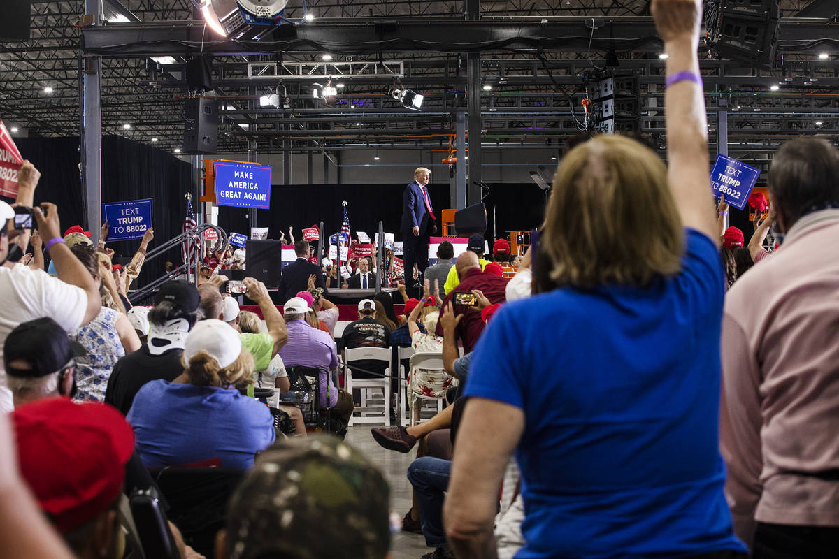 President Donald Trump addresses a large crowd at a campaign rally at Xtreme Manufacturing in H ...