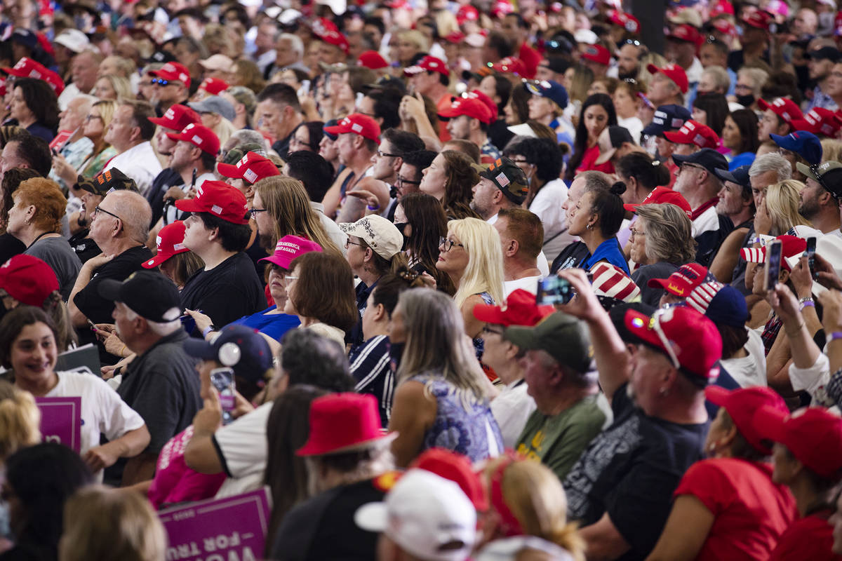 The crowd listens to President Donald Trump speak at a campaign rally at Xtreme Manufacturing i ...
