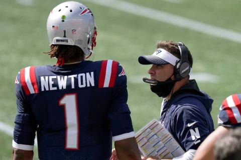 New England Patriots offensive coordinator Josh McDaniels, right, speaks to quarterback Cam New ...