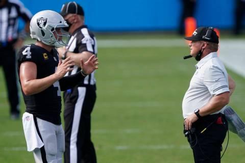 Las Vegas Raiders head coach Jon Gruden talks with quarterback Derek Carr during the second hal ...