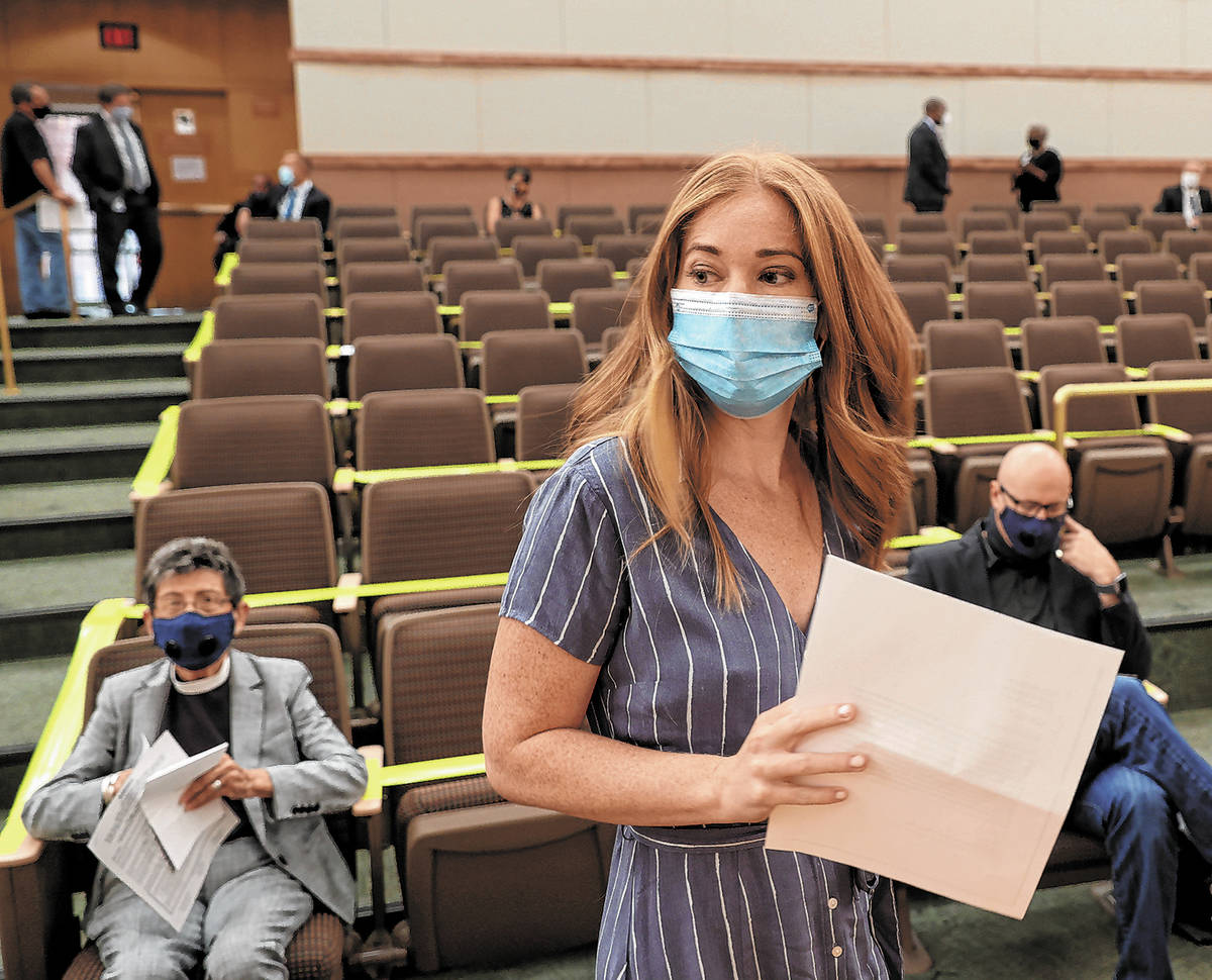 Kristen Corral, owner of Tacotarian restaurant, prepares to speak to Clark County Commissioners ...