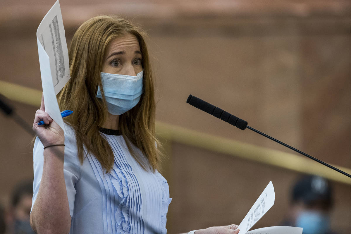 Owner Kristen Corral of Tacotarian restaurant holds up letters from fellow restaurant owners wh ...