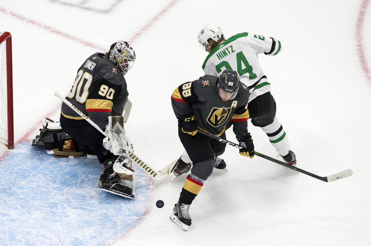 Dallas Stars' Roope Hintz (24) is stopped by Vegas Golden Knights' goalie Robin Lehner (90) as ...