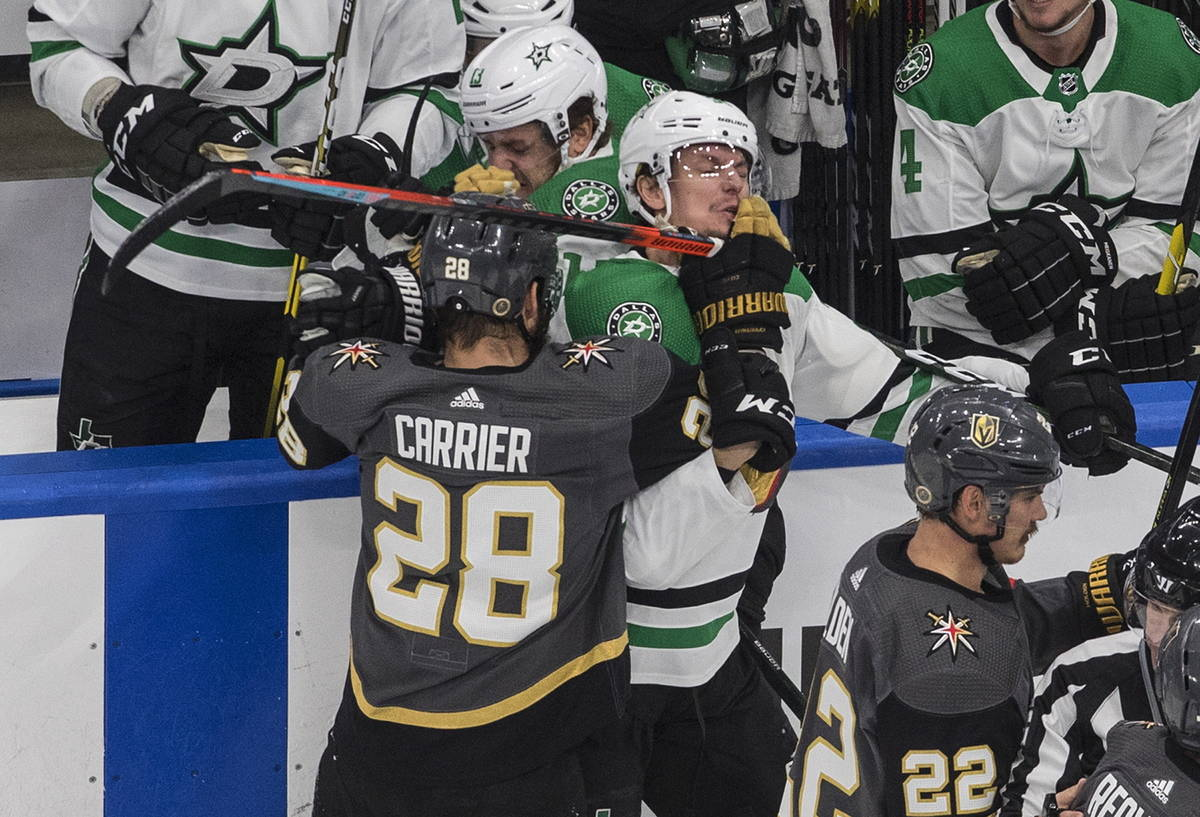 Dallas Stars' Denis Gurianov (34) and Vegas Golden Knights' William Carrier (28) rough it up du ...