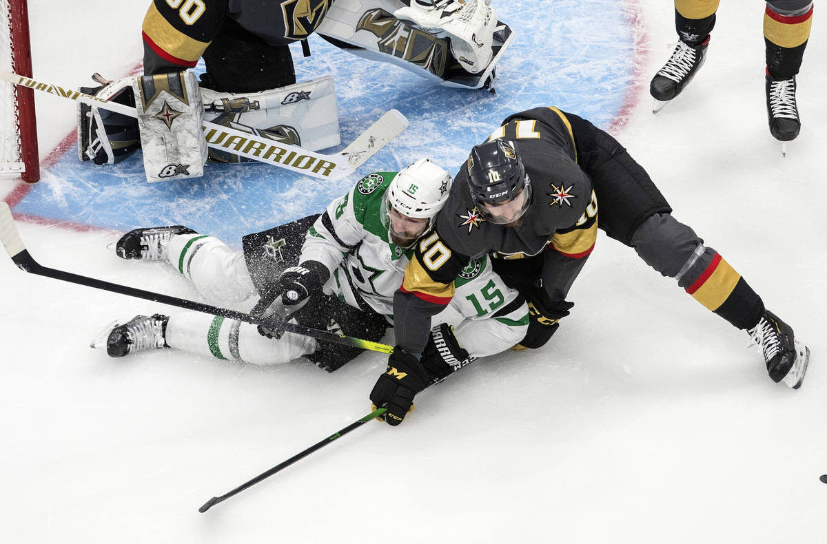 Dallas Stars' Blake Comeau (15) and Vegas Golden Knights' Nicolas Roy (10) battle in front of t ...