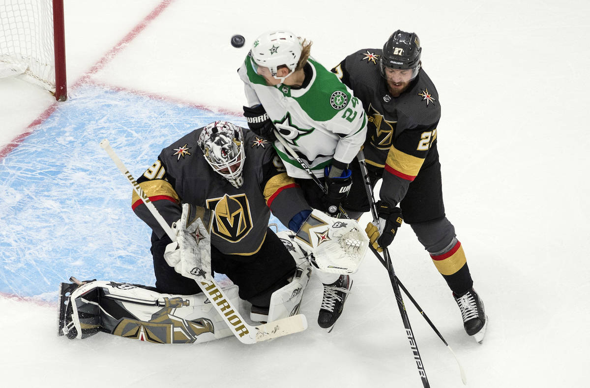 Dallas Stars' Roope Hintz (24) and Vegas Golden Knights' Shea Theodore (27) battle as Golden Kn ...