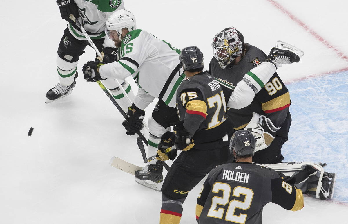 Dallas Stars' Blake Comeau (15) and Vegas Golden Knights' Ryan Reaves (75) battle for the rebou ...